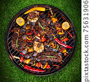 Top view of fresh meat and vegetable on grill 75631906