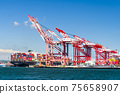 The container ship into the port of Kaohsiung, Taiwan. 75658907