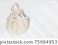 Reusable shopping bags on white background. Zero waste concept. 75664953