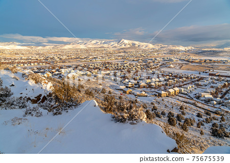 Sweeping view of homes in a picturesque neighborhood amidst scenic winter views 75675539