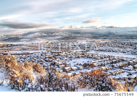 Picturesque landscape of neighborhood surrounded by mountain and snow in winter 75675549