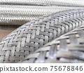 Long metal flexible compensator pipes metal texture 75678846