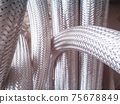 Long metal flexible compensator pipes metal texture 75678849