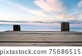 Panoramic view of Empty Wooden pier with bright blue skyline at the background. 75686515