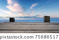 Panoramic view of Empty Wooden pier with bright blue skyline at the background. 75686517