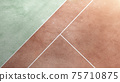 Tennis court from the above. Tennis court texture. Tennis background. Brown. Green. White 75710875