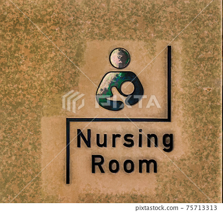 Symbol indicating a nursing room awaits the visitor behind this door. 75713313