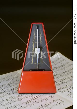 Metronome and sheet music 75726088