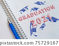 Concept of graduation 2021. Lettering in a school notebook 75729167