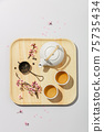 Tea concept, two white cups of tea and teapot on concrete background 75735434