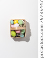 Easter composition with Decorated Easter eggs basket on white background 75735447
