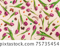 Easter composition with Pink tulips, chocolate eggs, bunnies and Jellybean pattern on pink background flat lay, top view. 75735454