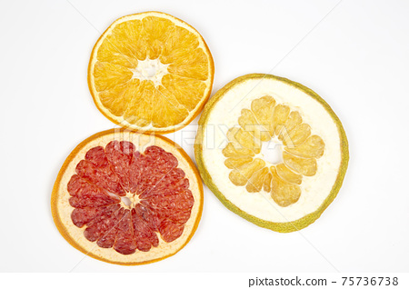 Dried slices of various citrus fruits on white background 75736738
