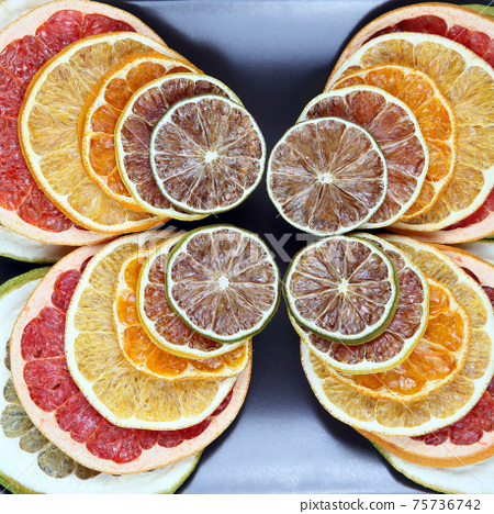 mix different pieces of dried citrus fruit on a plate 75736742