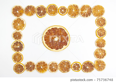 frame of dried lemon slices on a white background. vitamin fruit food 75736748