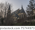 View of gothic church of saint Apolinar in czech Kostel sv. Apolinare with bare trees at old Prague center 75744973