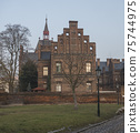 Czech Republic, Prague, February 23, 2021: View of building of Maternity Hospital Apolinar from Apolinarska street. A neogothic red brick facade complex from 19th century in Prague center, golden hour 75744975