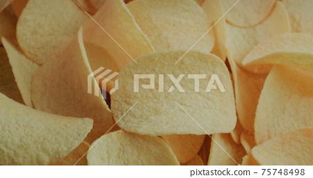 Top view: Crispy potato chips. 75748498