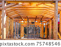 modern construction with wooden details, the new building are built environmentally friendly 75748546