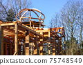 new wooden building frame with a round domed tower 75748549