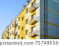 thermally insulated and visually restored facade of the apartment building 75748550