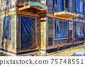 restoration of a wooden house by dismantling, assembling and replacing the damaged elements 75748551