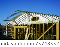 new wooden construction building in the construction process, roofing with waterproofing film 75748552