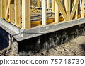 new wooden house frame concrete foundation waterproofing and damp proofing with bitumen membrane 75748730