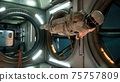 An astronaut in zero gravity checks the module of his spaceship. 3D Rendering. 75757809