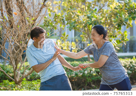 Happy asian senior husband and wife couples tease relax, male and female happiness old aged. 75765313