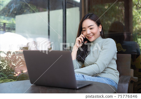 Female with cute smile having talking with mobile phone while rest in cafe. 75776846
