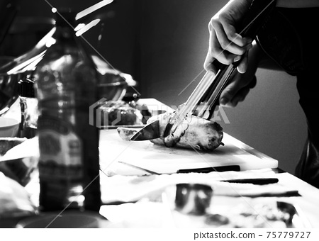 Chef cooking in a kitchen, chef at work, Black and White. 75779727
