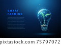 Abstract blue glowing light bulb with green plant inside 75797072