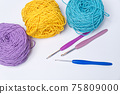 Various Color Yarn Balls with Knitting Needles iSolated on White Background 75809000