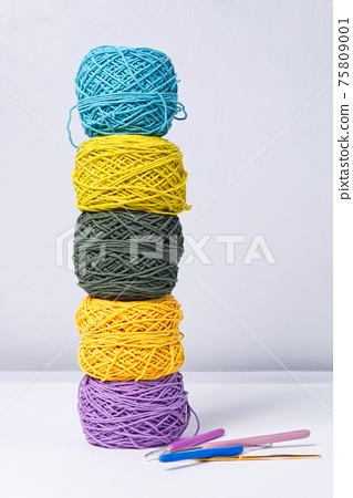Various Color Yarn Balls with Knitting Needles iSolated on White Background 75809001