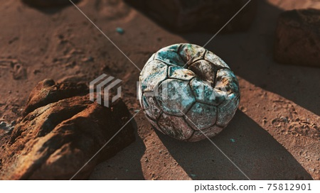 Old leather soccer ball abandoned on sand 75812901