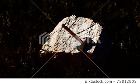 war ax for Viking on the rock at sunset 75812905