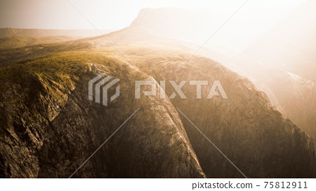 dry yellow grass on the rocky mountain with heavy fog 75812911