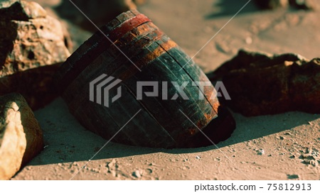 old wooden barrel at sand beach 75812913