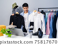 man selling clothes and accessories online by smartphone live streaming, business online e-commerce 75817670