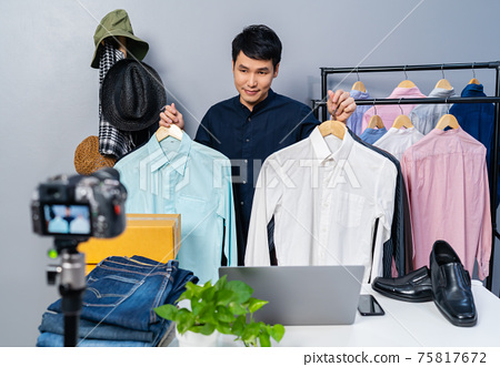 man selling clothes and accessories online by camera live streaming, business online e-commerce 75817672