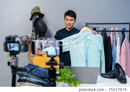 man selling clothes and accessories online by camera and smartphone live streaming, business online 75817674
