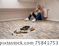 Selective focus on repair tools lying on laminate floor 75841753