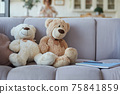 Teddy Bear plush toys sitting together on the sofa with notebooks for studying at home 75841859