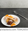 Carnival dessert on plate isolated on black background 75842650