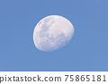 Moon in the afternoon on blue sky background 75865181