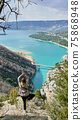 Woman look  on Guadalest water reservoir with turquoise water in Alicante province Spain 75868948