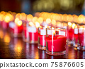 Candle and fire in glass 75876605