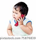 Cute Boy Using Mobile Phone 75876839