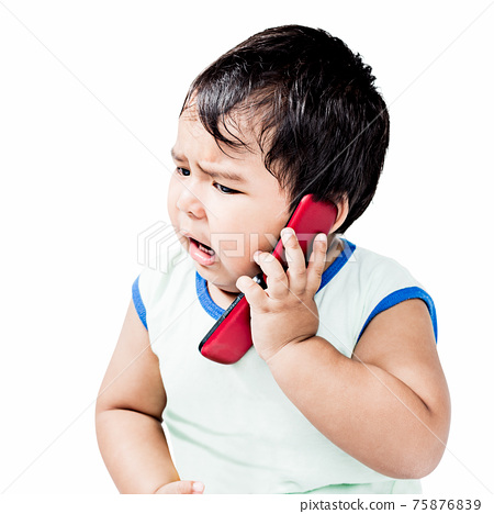 Cute Boy Using Mobile Phone 75876839